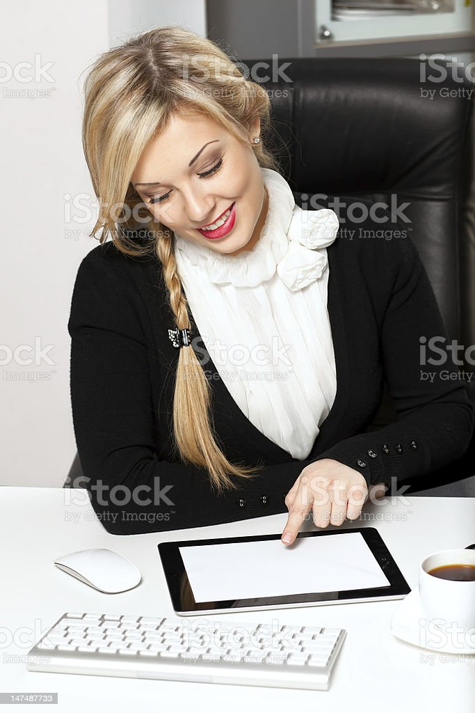 businesswoman in the office with tablet royalty-free stock photo