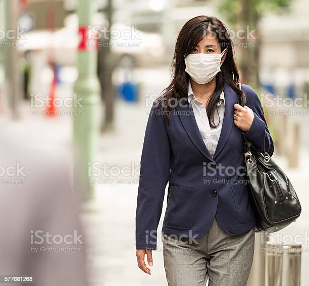 Businesswoman in tokyo wearing protective facemask picture id577661268?b=1&k=6&m=577661268&s=612x612&h=ds0poxf2 r91cctmd7x3uwpcyjb95dvtrgifct6dbsy=