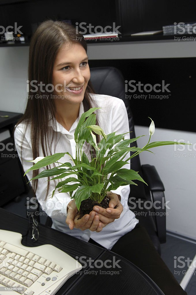 Businesswoman in touch with nature royalty-free stock photo
