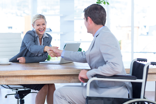 660681964 istock photo Businesswoman interviewing disabled job candidate 691094594