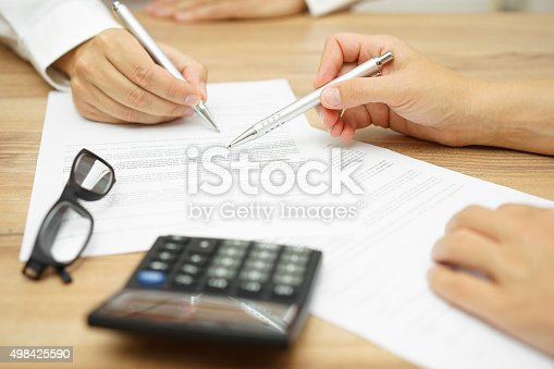istock Businesswoman is explaining terms and conditions in agreement to client 498425590