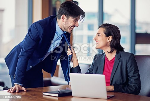Businesswoman is flirting with her coworker in the office