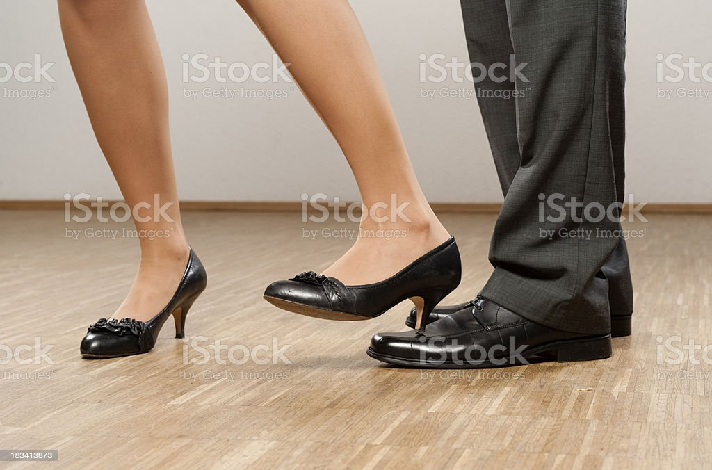 Businesswoman is stepping on feet of colleague royalty-free stock photo