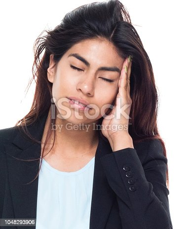 Businesswoman is suffering from a headache. She is a latino.