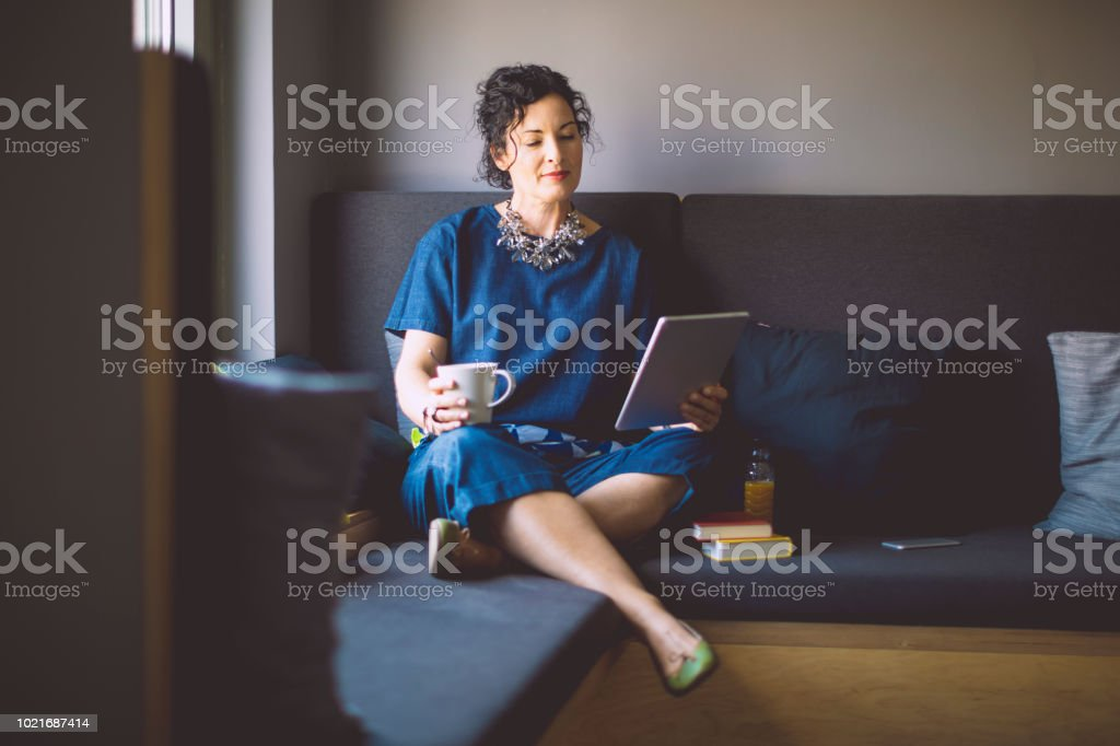 Businesswoman is taking a break in a cosy corner