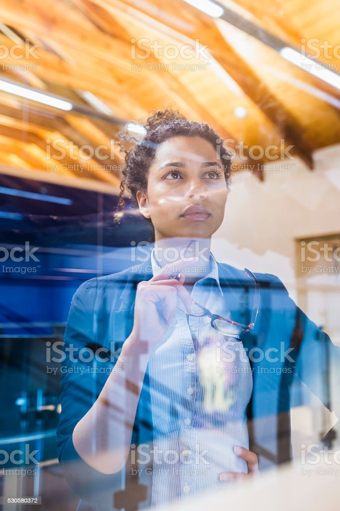 Businesswoman is thinking about work strategies stock photo
