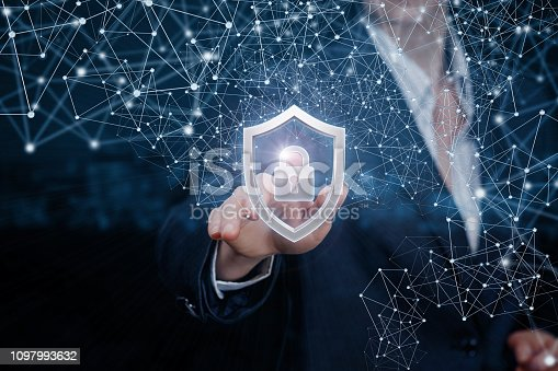 istock A businesswoman is touching a padlock inside a shield. 1097993632