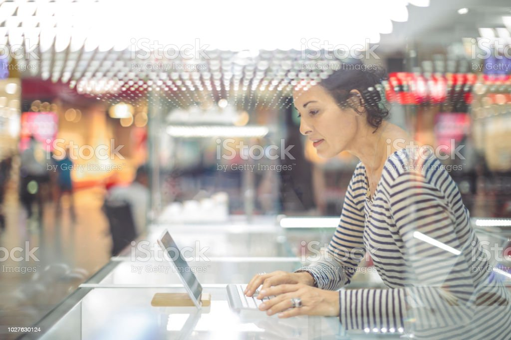 Businesswoman is working on her digital tablet royalty-free stock photo