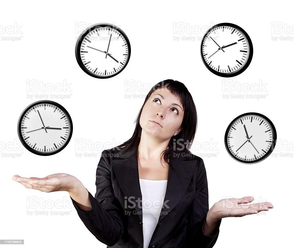 Businesswoman juggling clocks. royalty-free stock photo