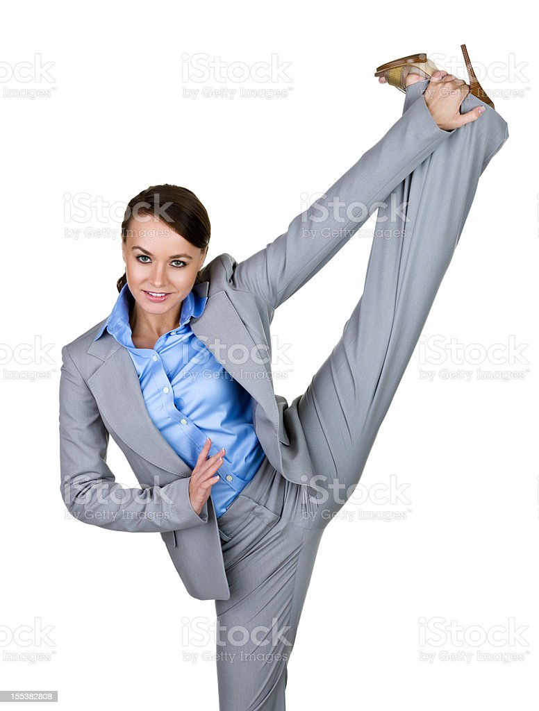 Businesswoman kicking stock photo