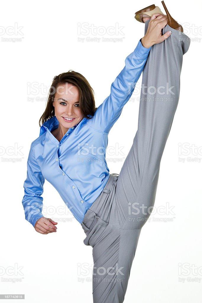 Businesswoman kicking stock photo