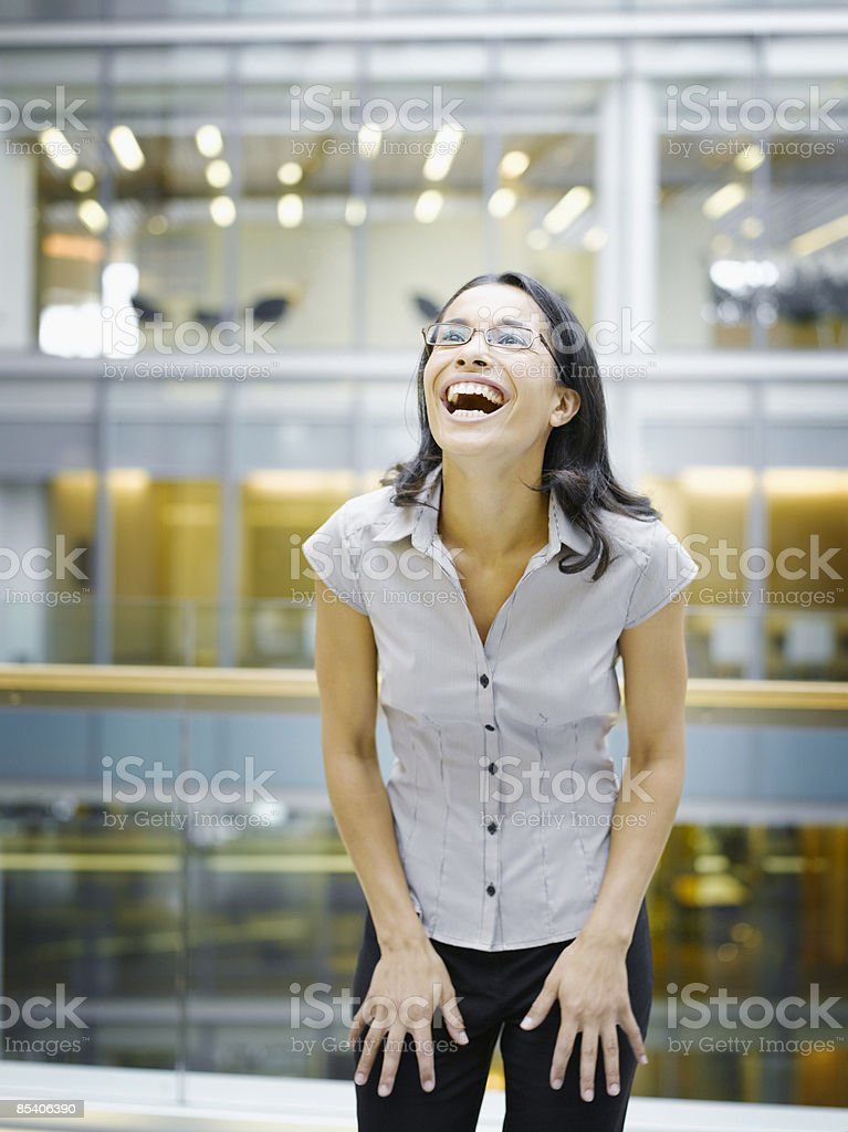 Businesswoman laughing royalty-free stock photo