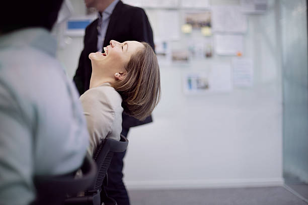 Businesswoman laughing reaction in office team meeting stock photo