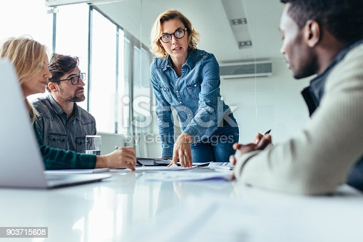 istock Businesswoman leading business presentation 903715608