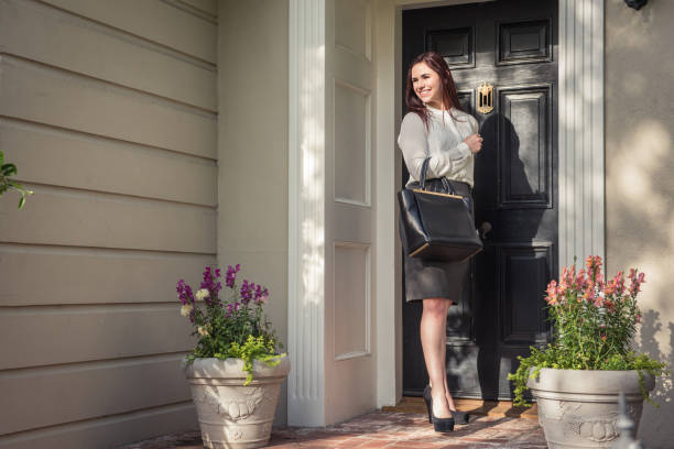 businesswoman leaving for work - leaving stock photos and pictures