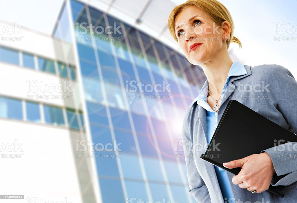 Businesswoman leaving her place of business royalty-free stock photo