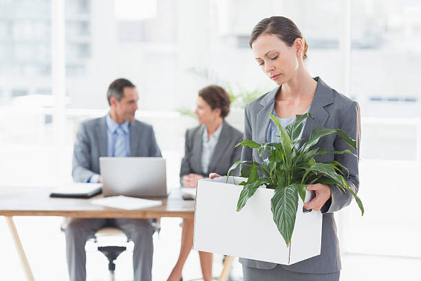businesswoman leaving office after being fired - leaving partnership corporate business sitting stock photos and pictures