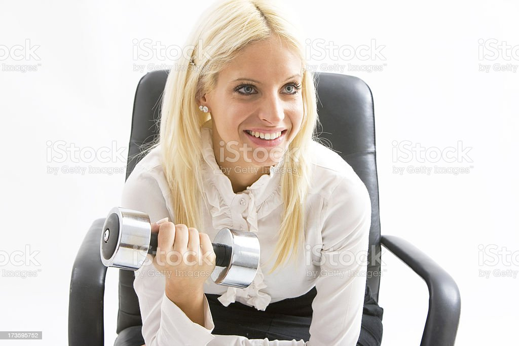 Businesswoman lifting weight royalty-free stock photo