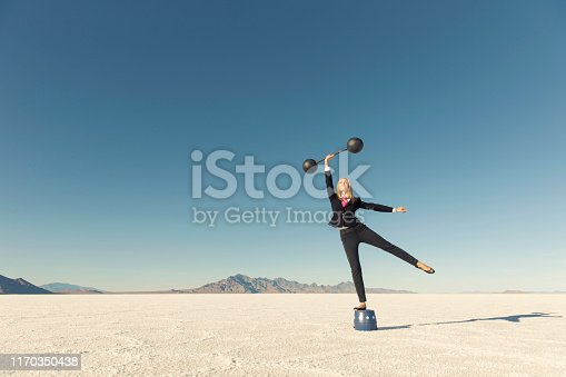 istock Businesswoman Lifting Weights for her Business 1170350438