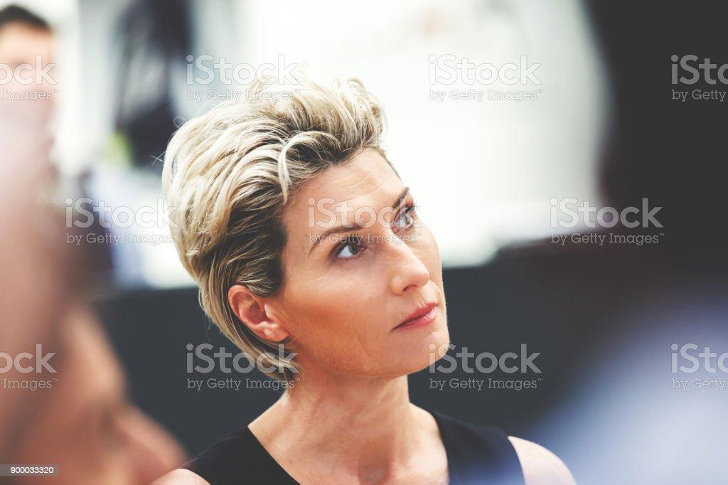 Businesswoman Listening During Meeting stock photo