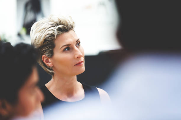businesswoman listening during meeting - selective focus stock pictures, royalty-free photos & images