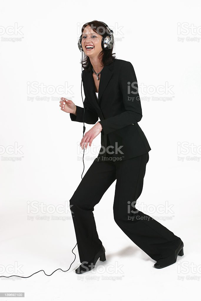 Businesswoman listening to her favorite music royalty-free stock photo
