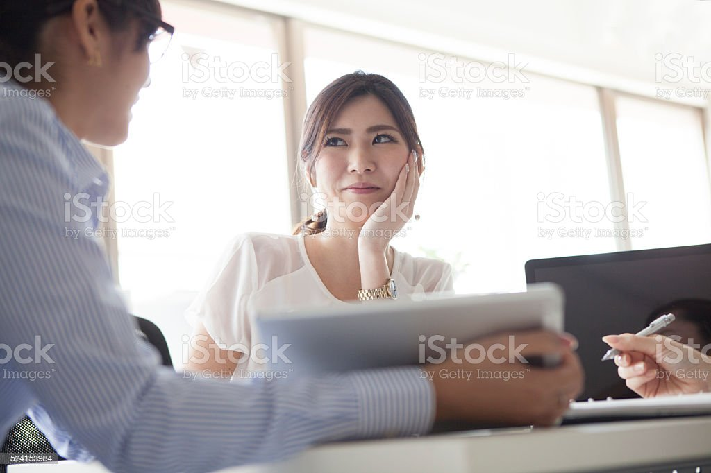 Businesswoman listening to the opinion of colleagues