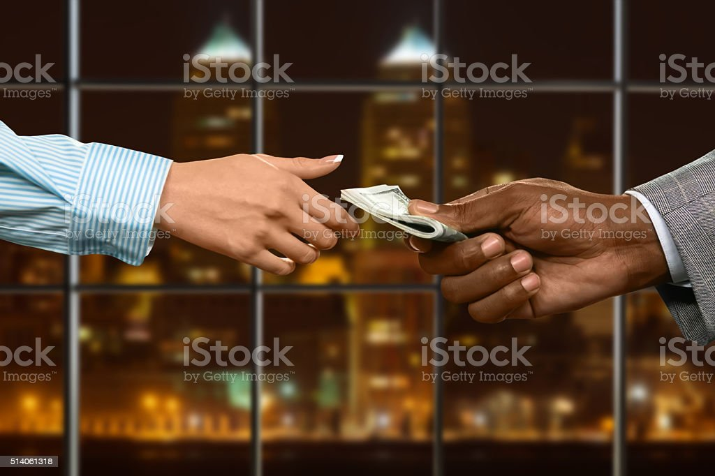 Businesswoman loans money in office. stock photo