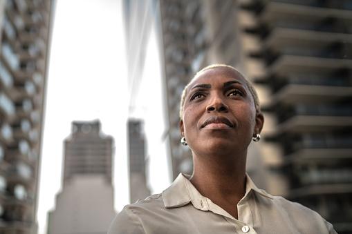 Businesswoman loking away outdoors