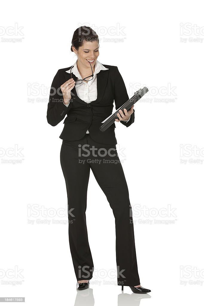Businesswoman looking at a file and smiling royalty-free stock photo