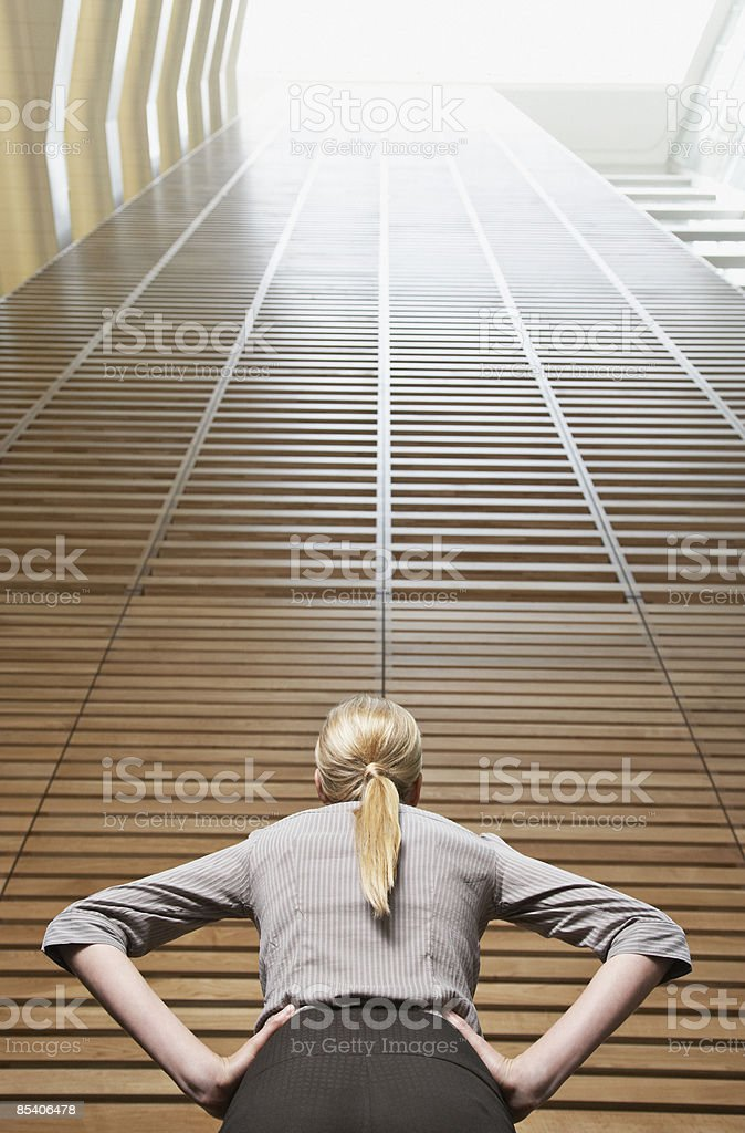 Businesswoman looking at atrium wall royalty-free stock photo
