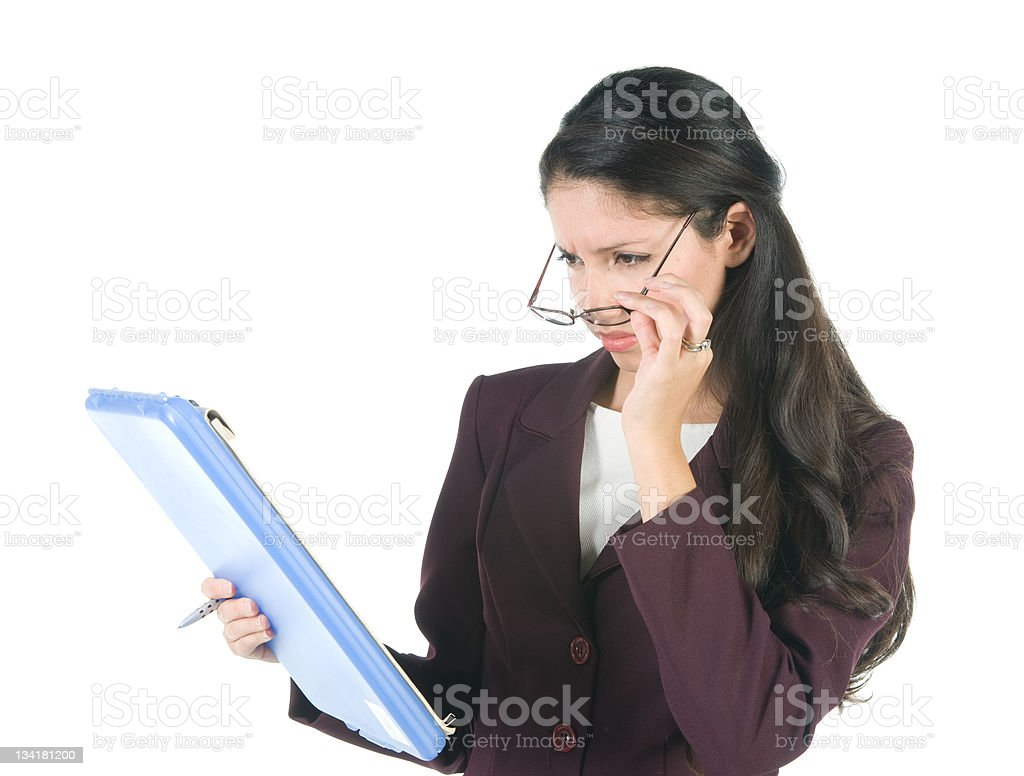 Businesswoman Looking at Clipboard stock photo