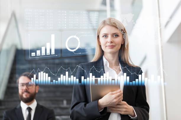businesswoman looking at financial data on futuristic display - business woman hologram imagens e fotografias de stock