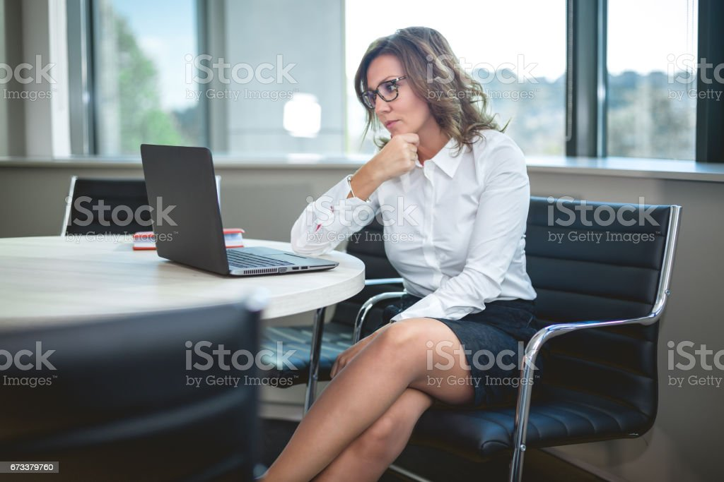 CEO businesswoman looking at laptop stock photo