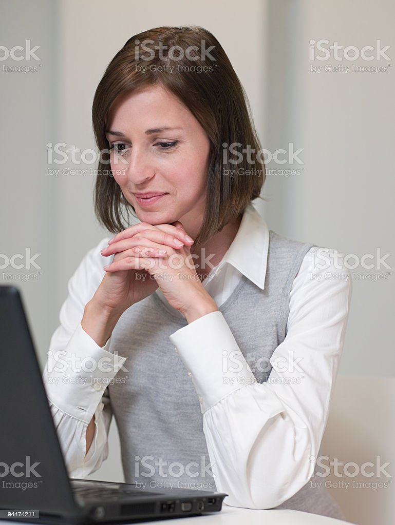 Businesswoman looking at laptop stock photo