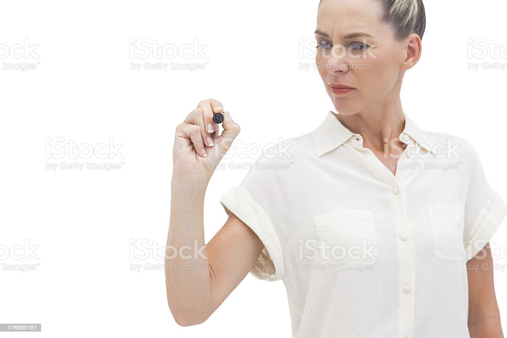 Businesswoman looking at pen in her hand royalty-free stock photo