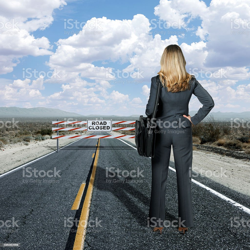 Businesswoman Looking At Road Block On Long Staight Highway royalty-free stock photo