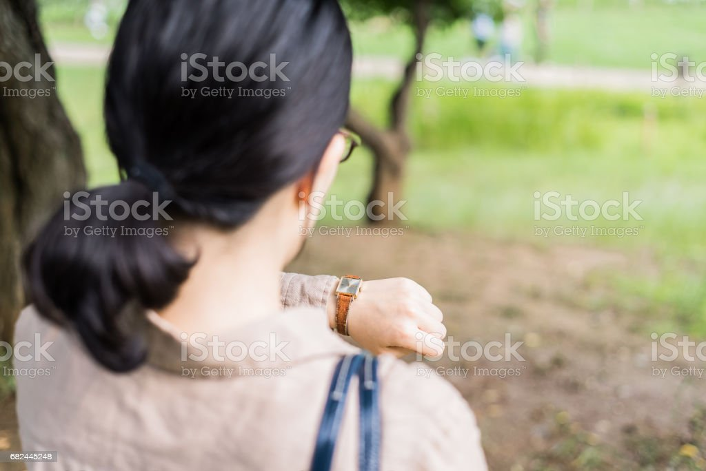 Businesswoman looking at the watch royalty-free stock photo