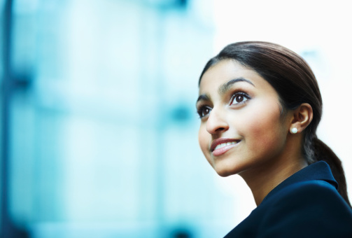 Businesswoman Looking Away And Smiling Stock Photo - Download Image Now
