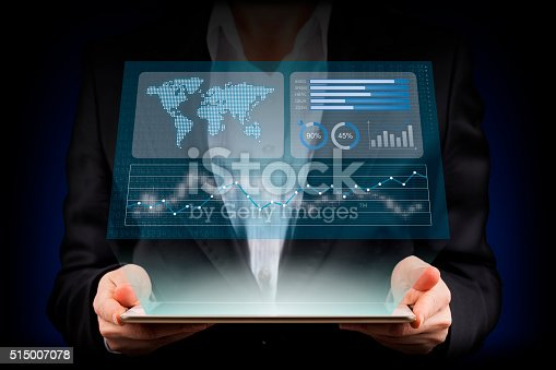 istock Businesswoman looking financial graphics on tablet computer 515007078