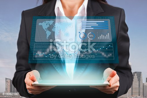 istock Businesswoman looking financial graphics on tablet computer 515062192