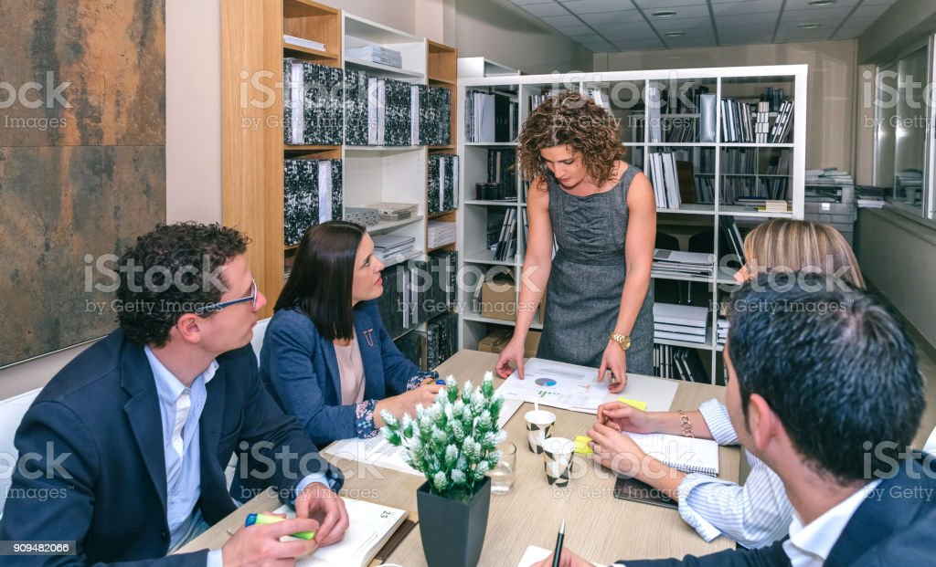 Businesswoman looking graphs in a meeting stock photo