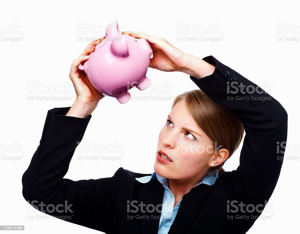 Businesswoman looking into a piggybank royalty-free stock photo
