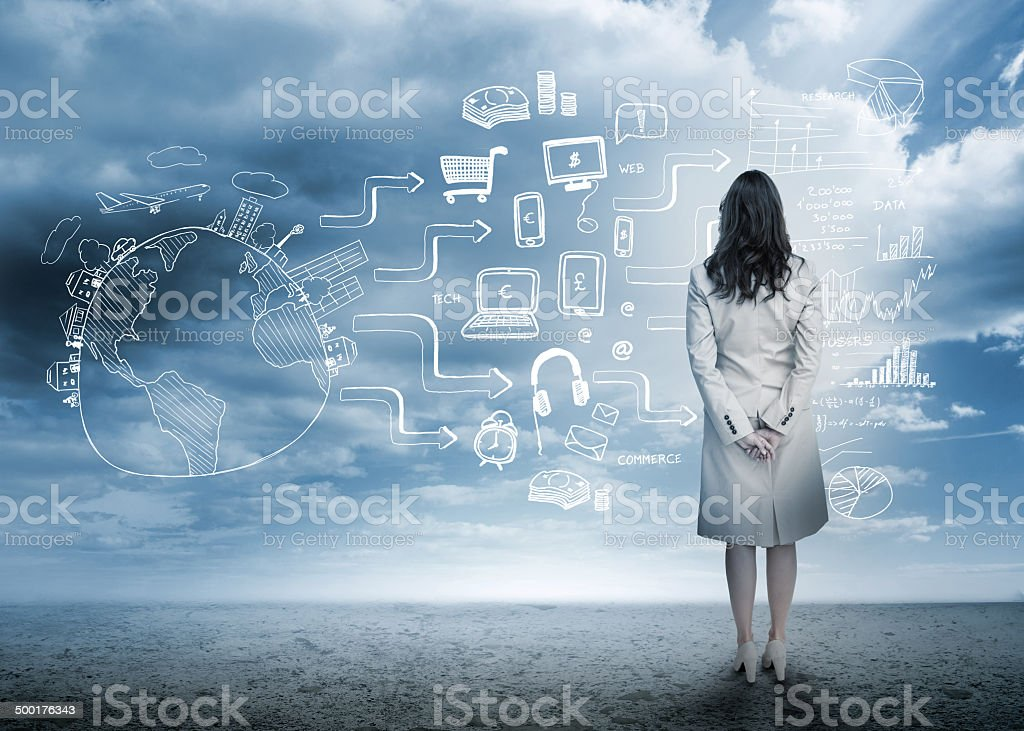 Businesswoman looking out at brainstorm drawings stock photo