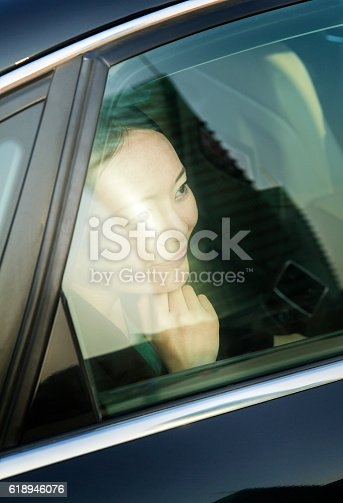620402800istockphoto Businesswoman looking out of car window 618946076