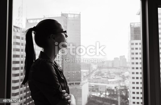 Businesswoman looking out the window.