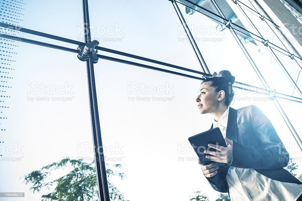 Businesswoman looking outside the window royalty-free stock photo