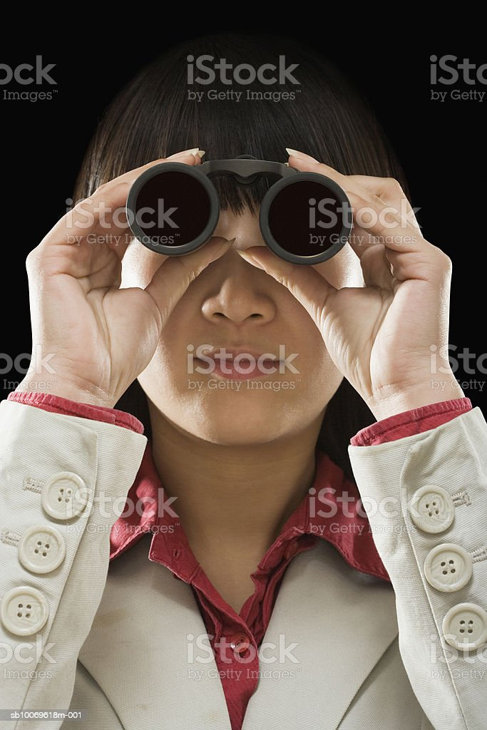 Businesswoman looking through binoculars royalty-free stock photo