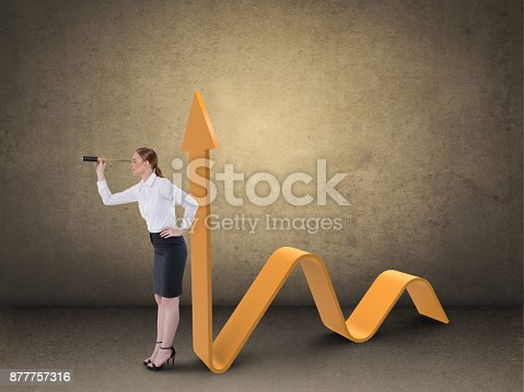 904389218istockphoto Businesswoman looking through spyglass by business graph 877757316