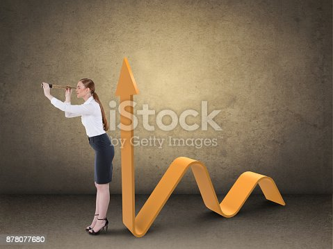 904389218istockphoto Businesswoman looking through spyglass by business graph 878077680